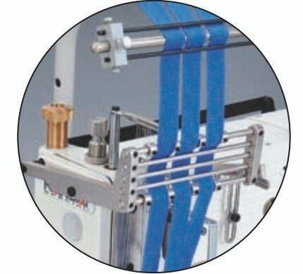 Kansai Special FX-4412P-UTC Машина може бути обладнана направляючими для пришивання лампасів.